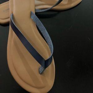 Navy colored flip flops